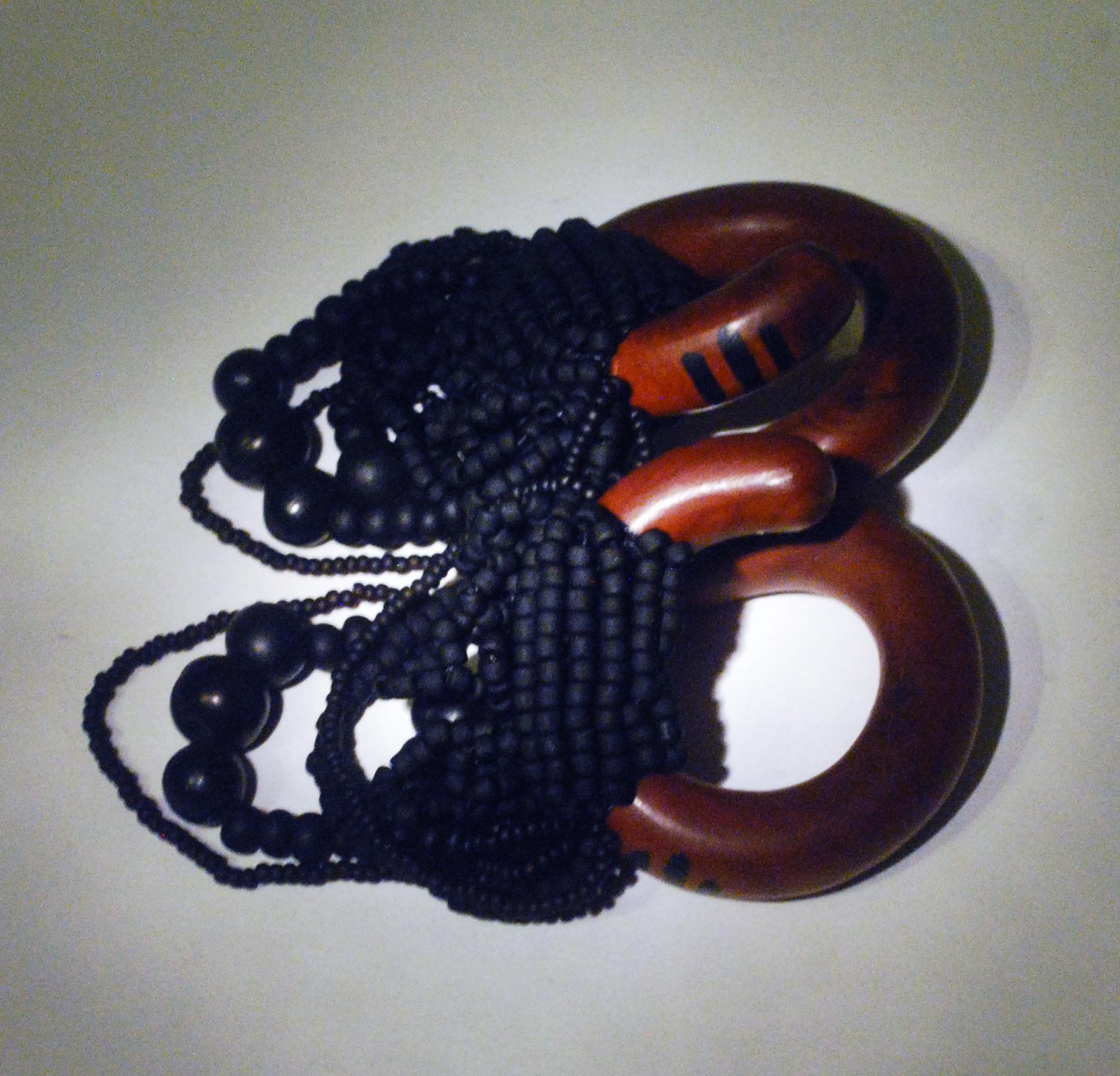 black glass beadweaving on sawa wood coils