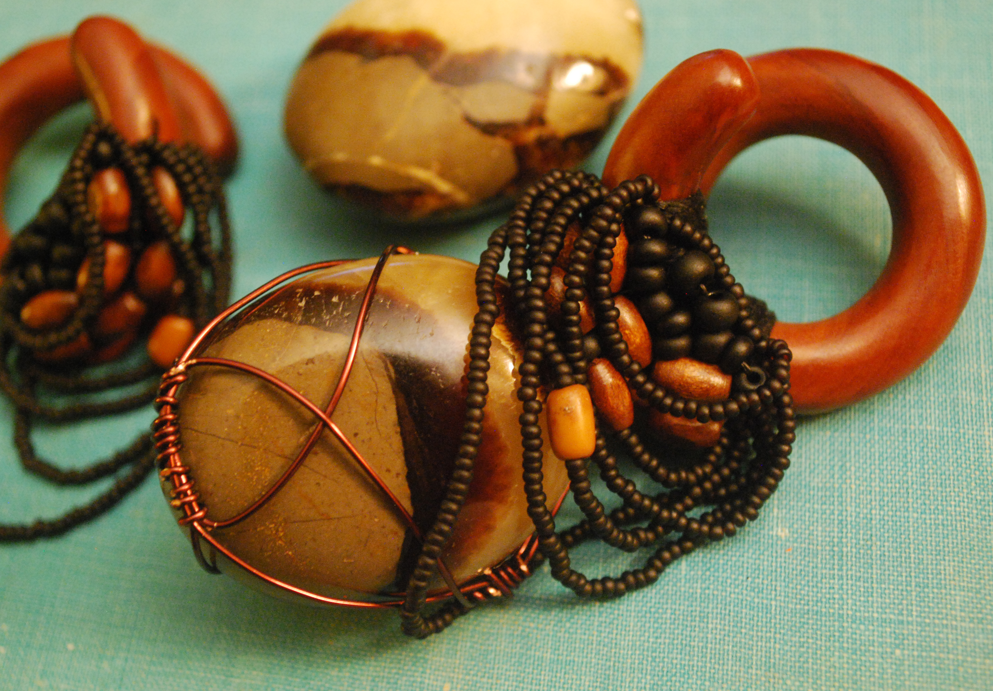 "set I'm working on- 1/2"" saba wood with glass, oak, and maple beads, silk threadwrapping, and copper-wrapped hand polished agates."