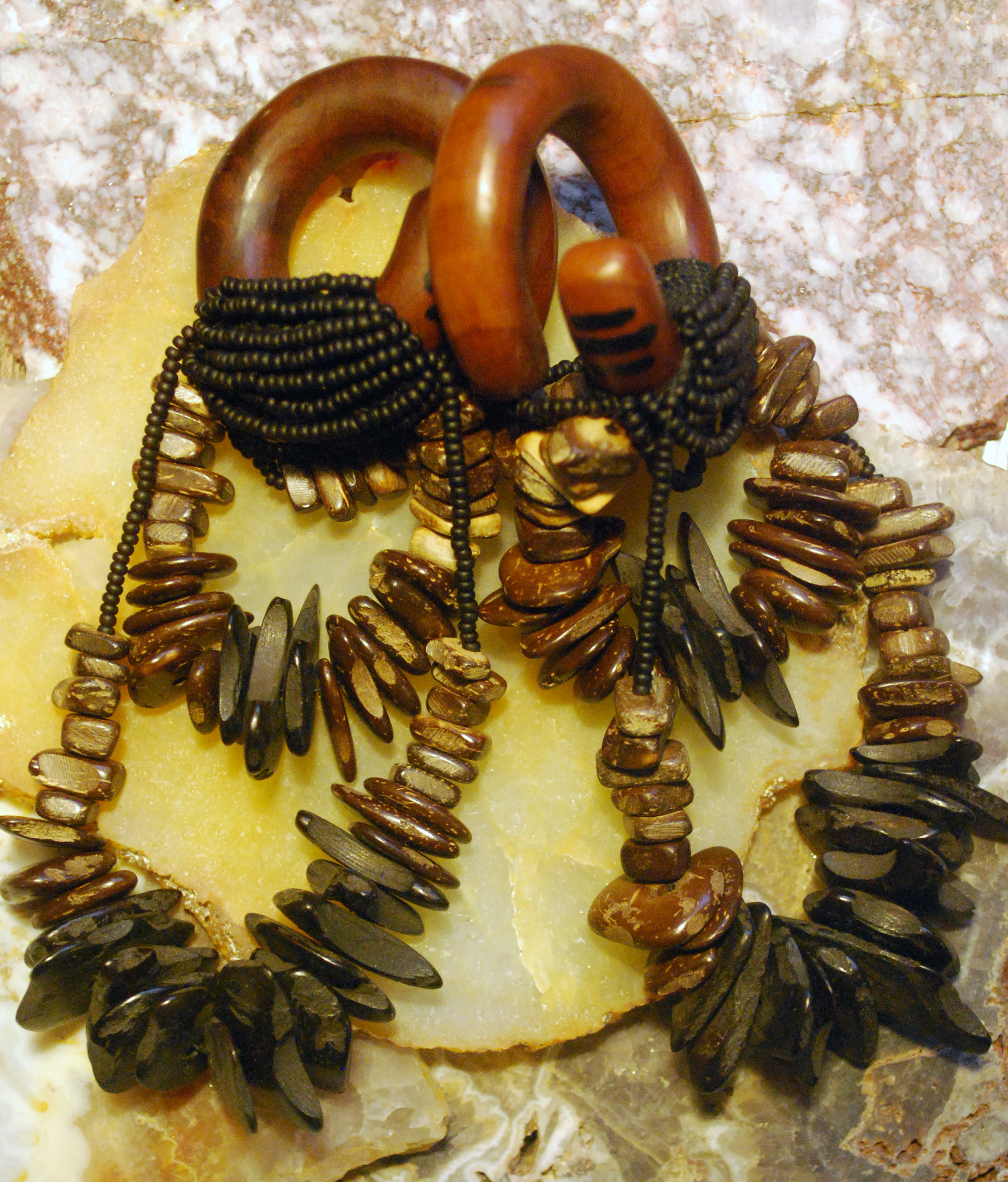 "new set, these are for sale at laughing buddha in seattle. 7/16"" saba wood with oak and nut dangling on silk wrapping."